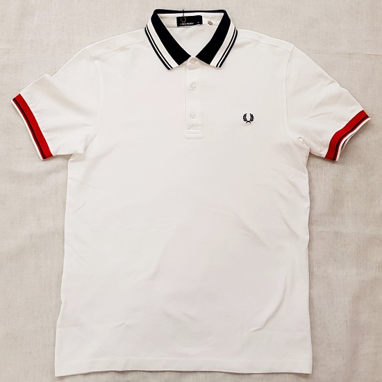 POLO IN PIQUÉ CON RIGHE COLOUR BLOCK
